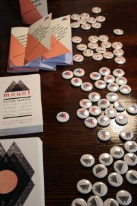 button badges and postcards by our resident graphic designer