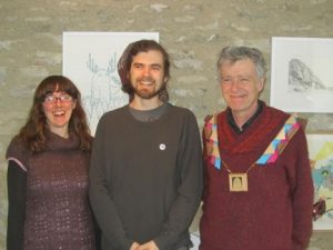 Peter Macfayden with Framemaker Simon Keyte and graphic designer Jennifer Newbury of Mount Art Services